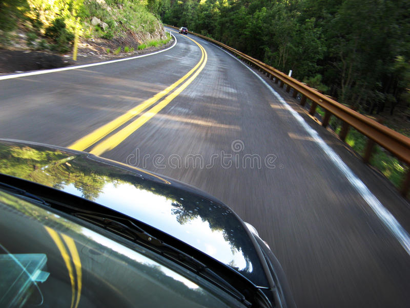 Car Driving Fast. In forrest road stock photo