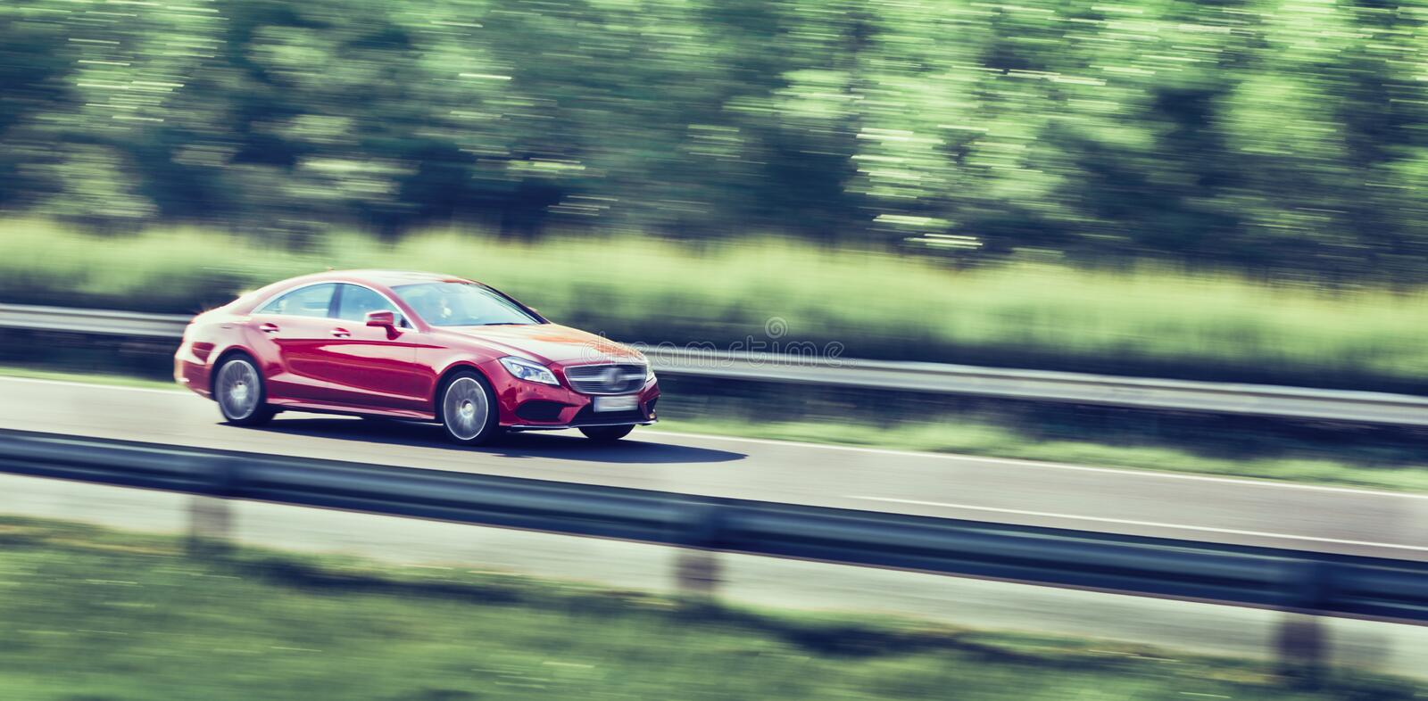 Car driving fast on highway motion blur. Image royalty free stock photos