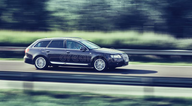 Car driving fast on highway motion blur. Image stock photos