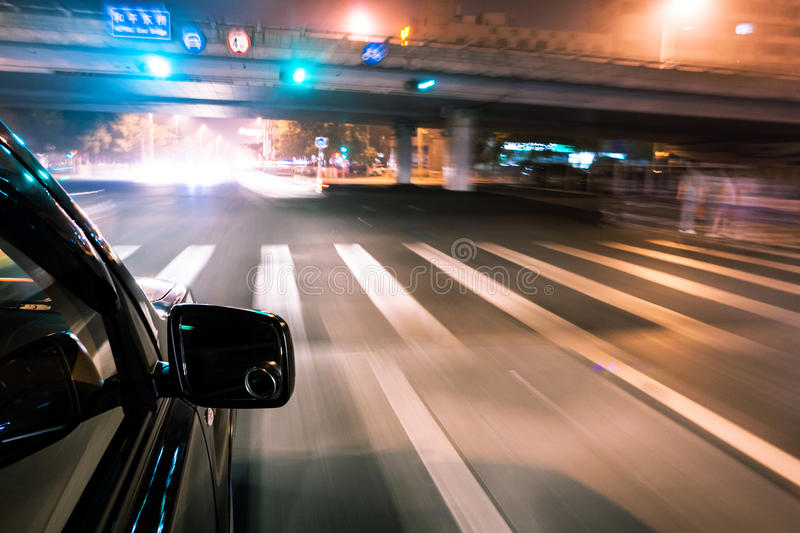 Car driving fast. In modern city royalty free stock images