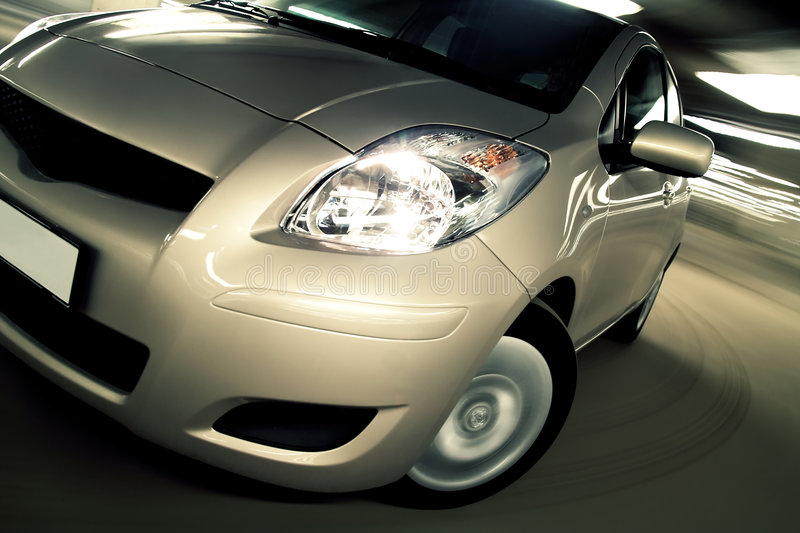 Car driving fast in parking house stock photo