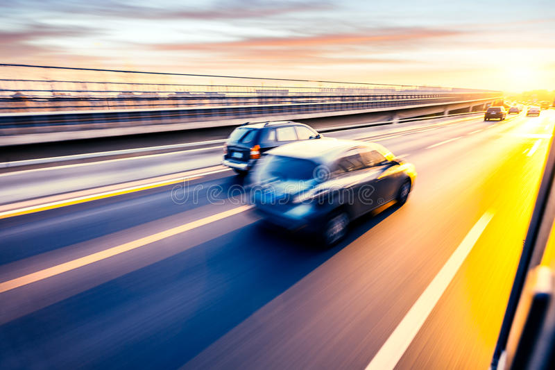 Car driving on freeway, motion blur royalty free stock photos