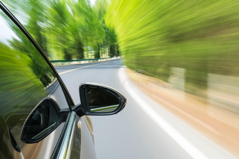 Car driving with green motion blur. Green road with car driving motion blur stock photography