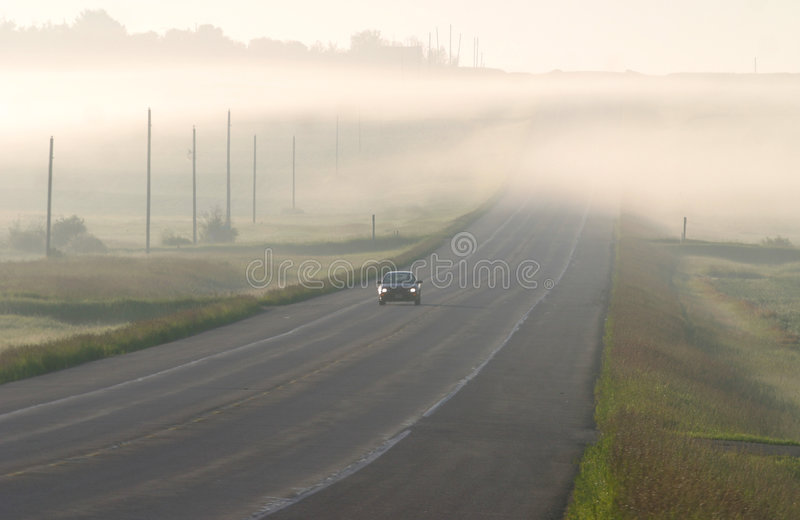Download Car Driving Through The  Mist Stock Image - Image of scenic, highway: 159339