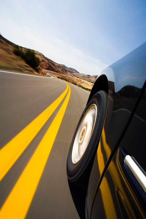 Car driving through mountains stock image