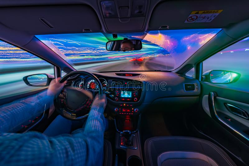 Car driving at night royalty free stock images