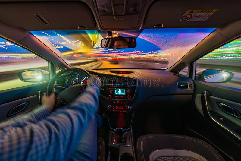 Car driving at night royalty free stock photography