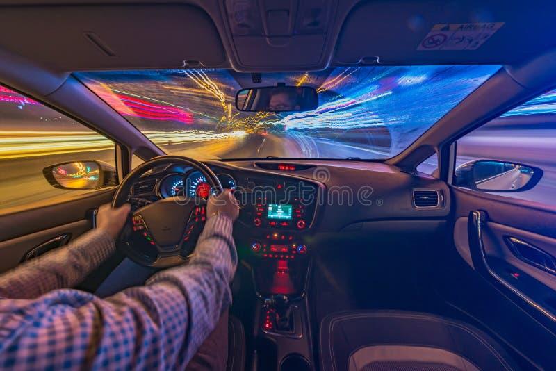 Car driving at night stock image