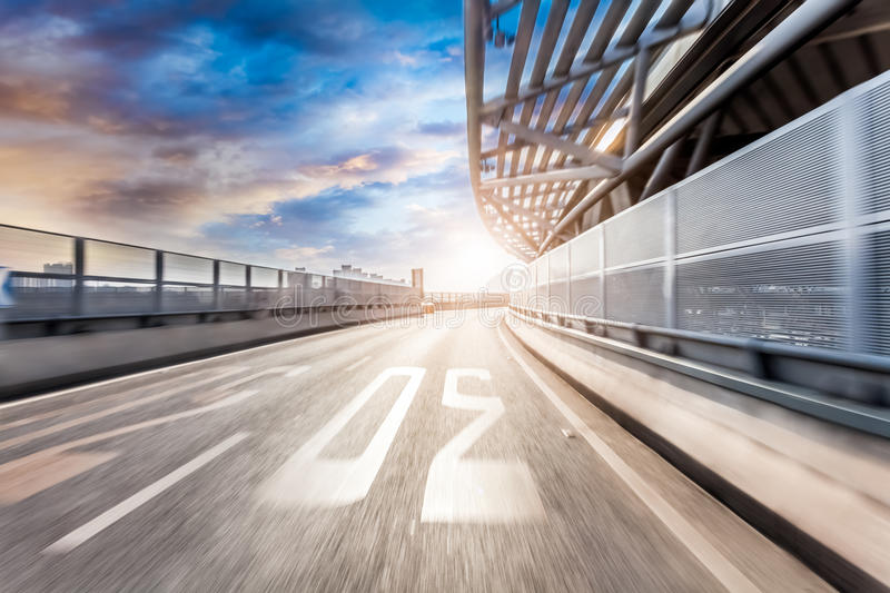 Car driving on road in city background, motion blur.  stock images