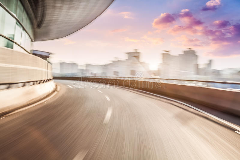 Car driving on road in city background, motion blur.  royalty free stock photos
