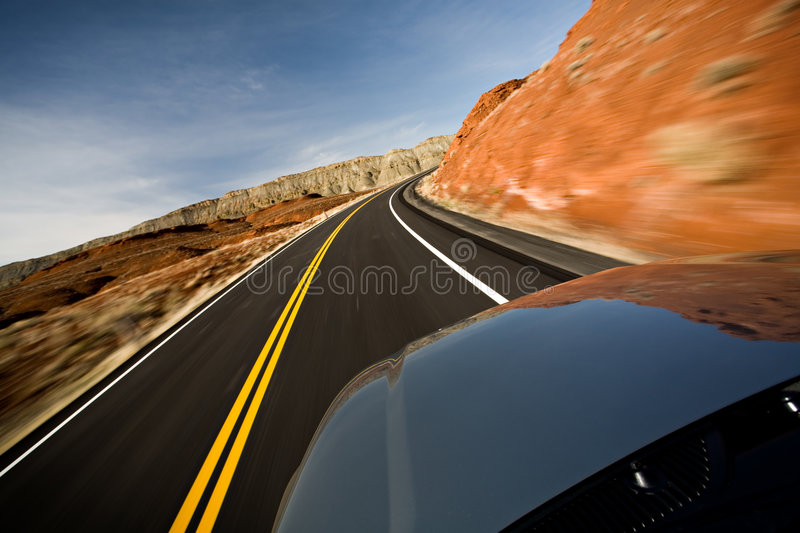 Car driving on road with motio royalty free stock image