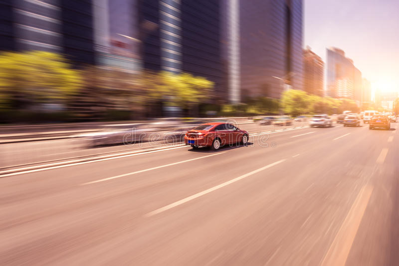 Car driving on road at sunset, motion blur.  stock images