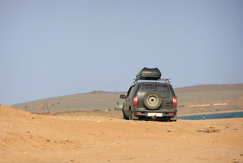 Download A Car Is Driving Through Sands Stock Photo - Image: 4845616