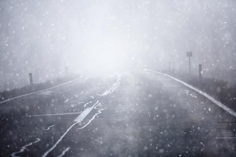 Car driving on snowy and slippery road royalty free stock photo