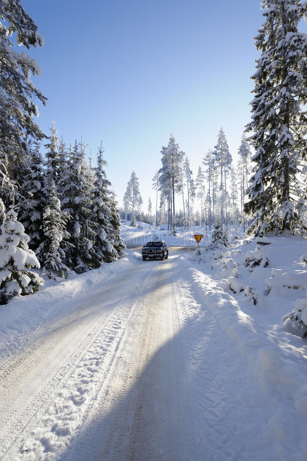 Download Car Driving Through Snowy Winter Stock Photo - Image of trees, season: 22404380