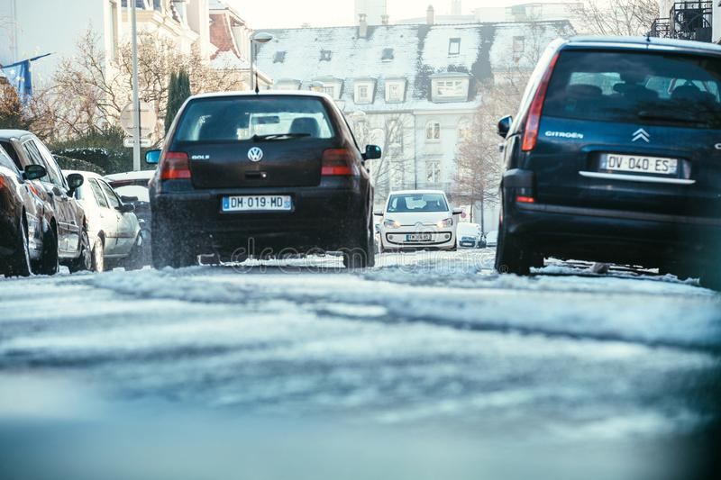 Car driving in Strasbourg on snowy road in winter royalty free stock photos
