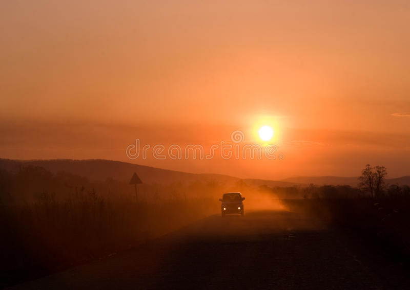 Download Car driving at sunset stock photo. Image of scenic, landscape - 19346226