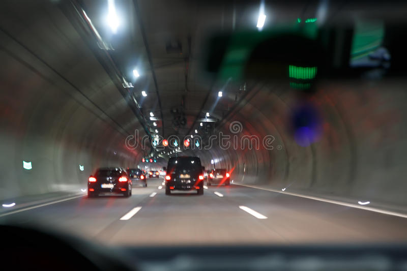 Car driving throught tunnel; highway tunnel at night stock photography