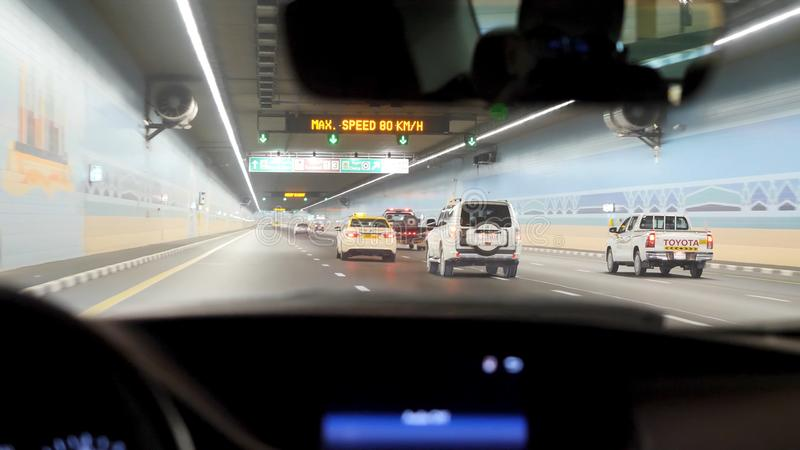 Car driving through tunnel, highway tunnel at night. Interior of an urban tunnel with car,motion blur. Cars leaving royalty free stock images