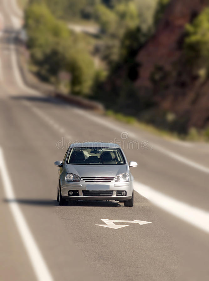 Car driving. Vertical with defocused in Catalonia, It is a vertical picture on a sunny day royalty free stock images