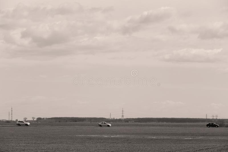 Car driving in the wild. Car driving a road in the middle of a green field royalty free stock photography
