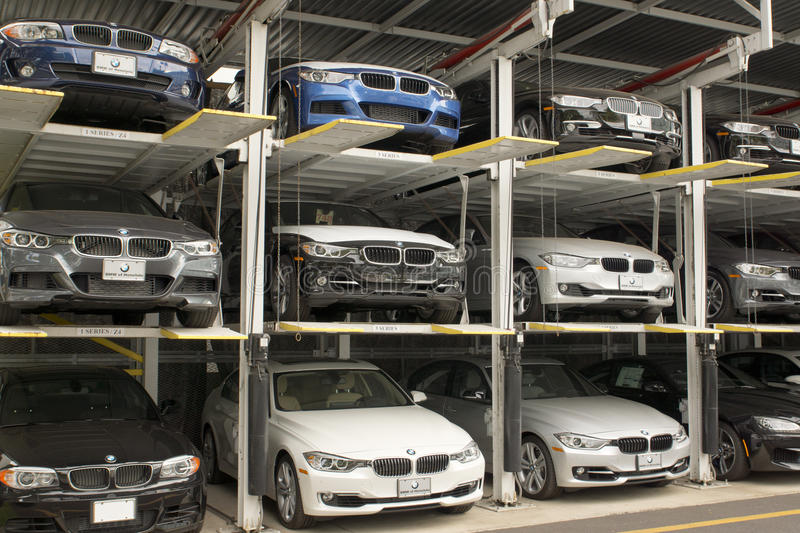 Car elevator lift. Cars stored in an elevator lift at a car dealership stock photography