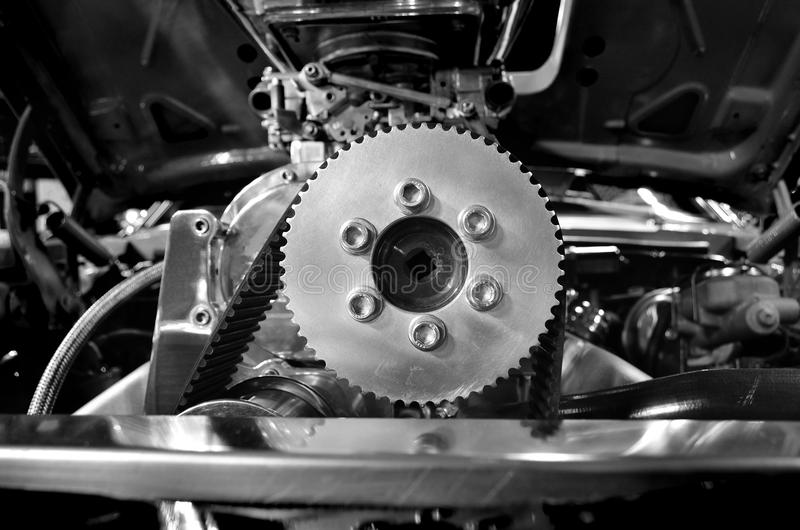 Car Engine. Detail of parts of operating car engine stock image