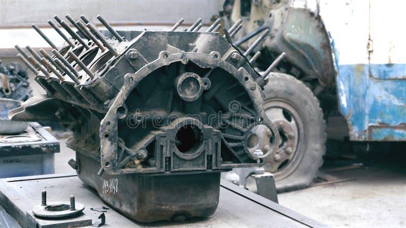 Car engine, broken in workroom stock photo