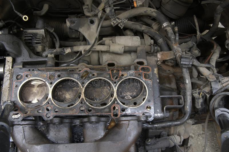 Car engine lower part , after head gasket failure, oil spilled. Head gasket failure of old car engine detail, replacing head gasket, old gasket, oil spill stock photos