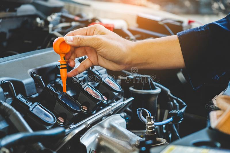 Car Engine oil mechanic working in auto repair service.  stock image