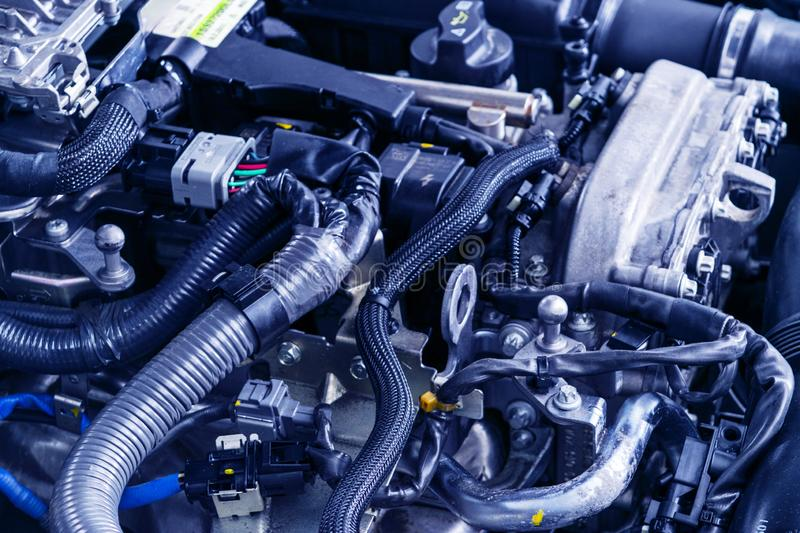 Car engine. Car engine part. Close-up image of an internal combustion engine. Engine detailing in a new car.  royalty free stock photos