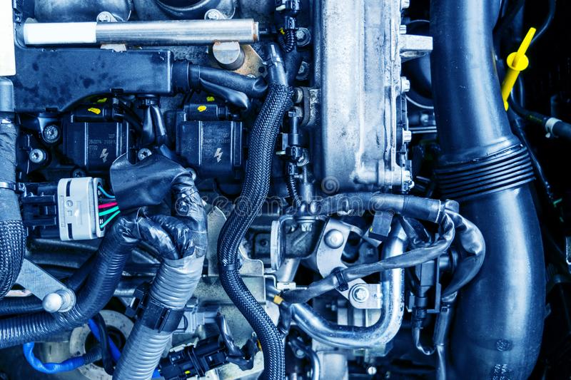 Car engine. Car engine part. Close-up image of an internal combustion engine. Engine detailing in a new car. Car detailing. Car engine. Car engine part. Close royalty free stock images