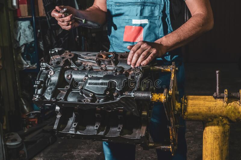 Car engine repair in the garage. Diagnostics and disassembly of parts for repair.  royalty free stock photos