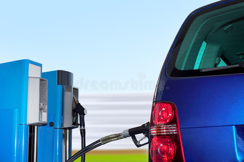 Car at Erdgas station. At the gas station pump putting gas into the car stock photography