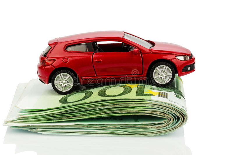 Car on euro notes. A car standing on euro bills. costs for the purchase of automobiles, gasoline, insurance and other car costs royalty free stock images