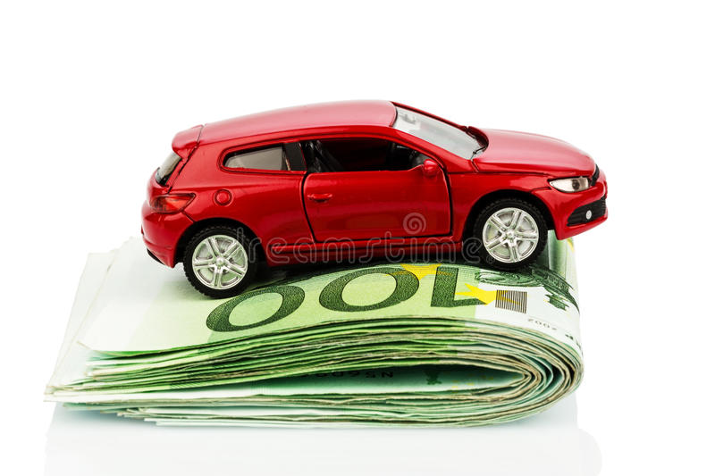 Car on euro notes. A car standing on euro bills. costs for the purchase of automobiles, gasoline, insurance and other car costs royalty free stock image