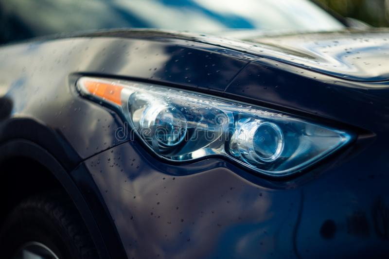 Car eyes. Close-up view. Fast and furious sport car.  royalty free stock image