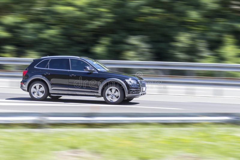 Car in fast motion with panning effect on highway stock photography