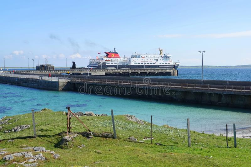 Car ferry at island ferry terminal. The Caledonian Macbrayne car ferry `Clansman` at the ferry terminal on the island of Tiree in Scotland stock photo