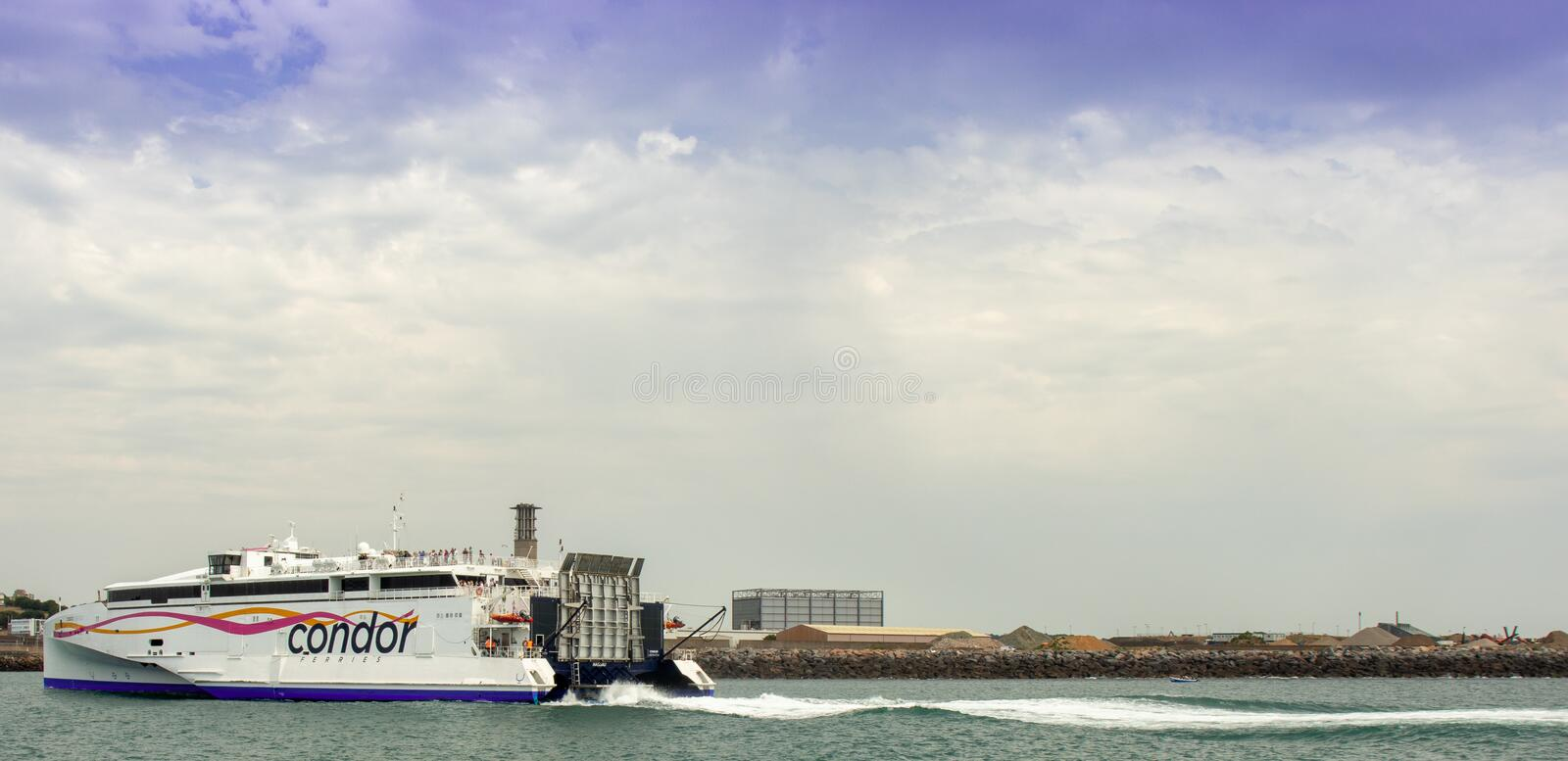 Car ferry about to dock in St Helier. St Helier, United Kingdom, - 07, 25, 2019: view from the sea of a car ferry arriving in port royalty free stock images