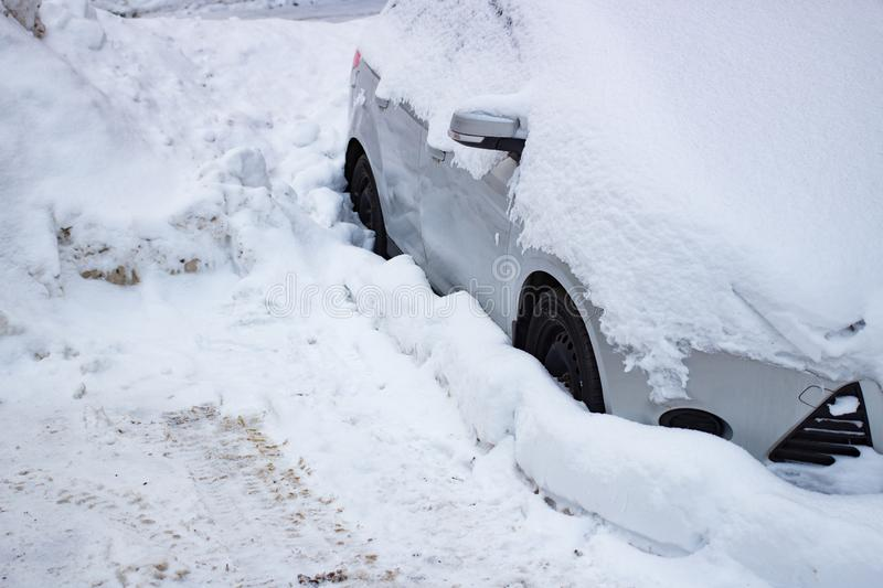 The car filled up by snow in the winter royalty free stock image