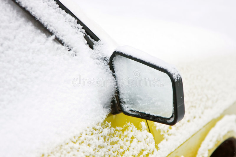 The car filled up by snow. Mirror with snow stock photos