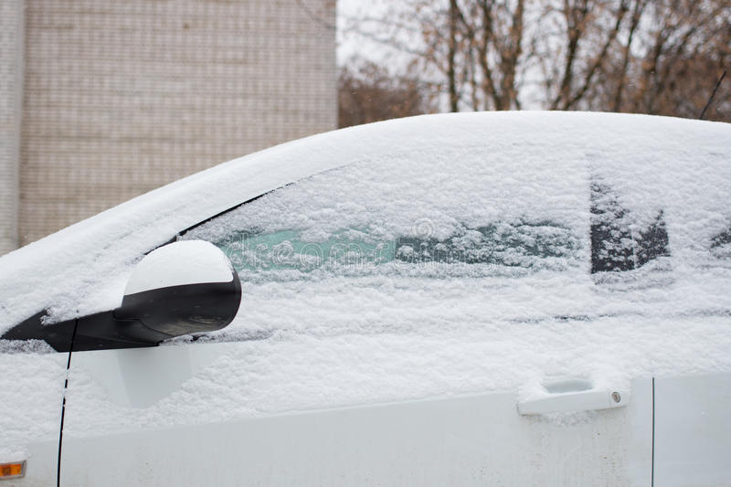 The car filled up by snow in the winter. The car filled up by snow in the daytime stock image