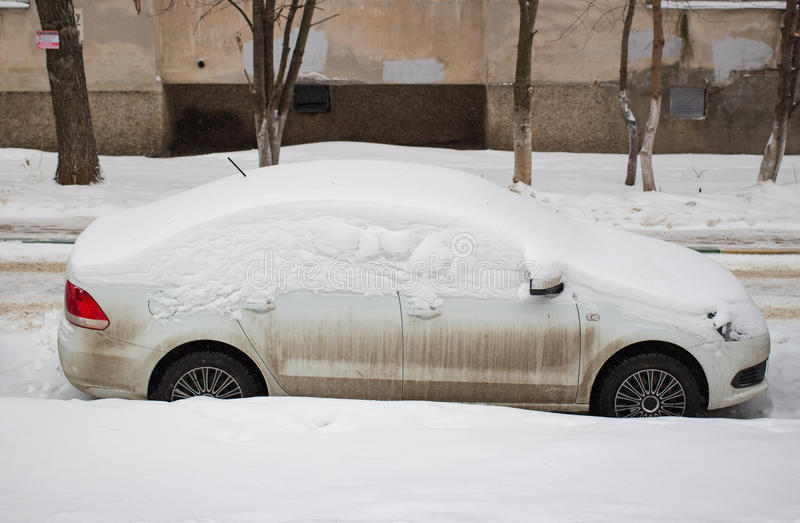 The car filled up by snow in the winter. The car filled up by snow in the daytime stock photography