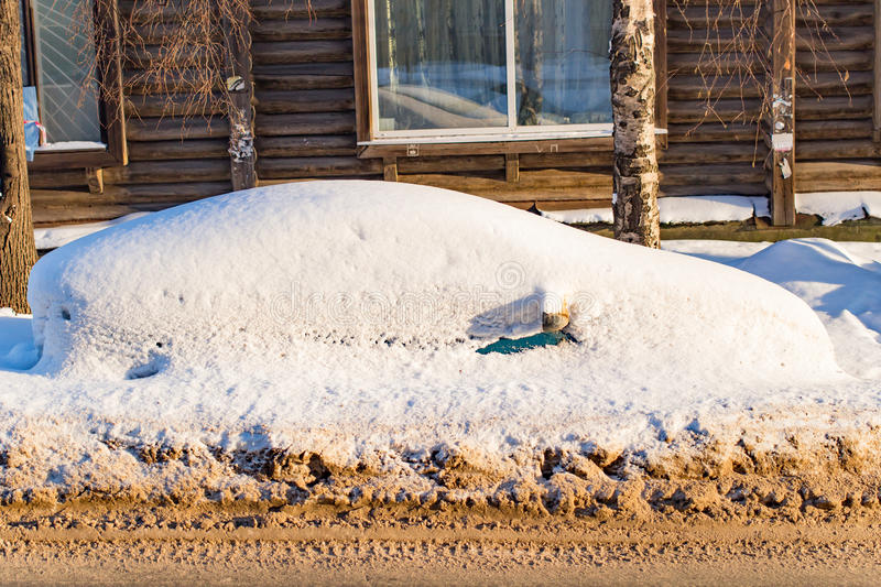 The car filled up by snow in the winter stock photos