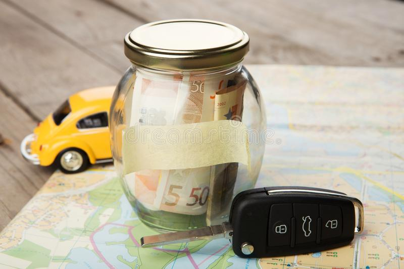 Car finance concept - money glass with word Rent, car key and roadmap. Car finance concept -money glass with word Rent, car key and roadmap stock images