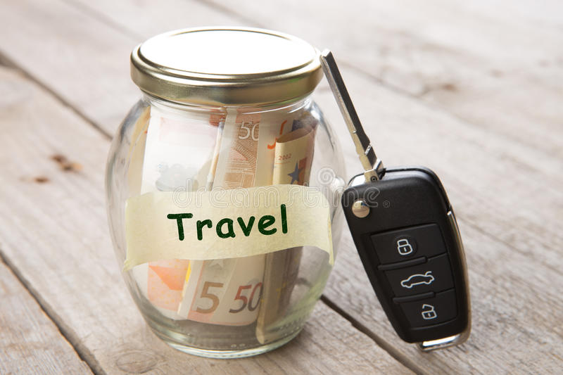 Car finance concept - money glass with word Travel, car key and roadmap. Car finance concept -money glass with word Travel, car key and roadmap stock images