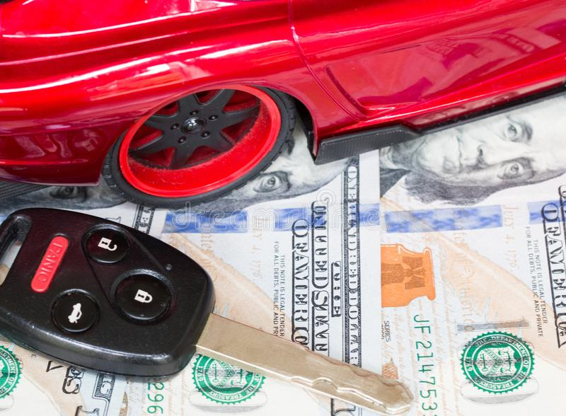Car financing and sales for a dealership. Car financing and sales for a dealership showing united states currency stock photo