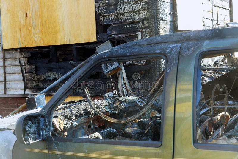 Abandoned burnt down car after an explosion, ready to be scrapped stock image