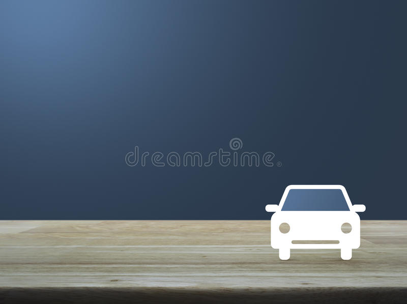 Car flat icon on wooden table over light blue gradient background, Business service car concept stock photography